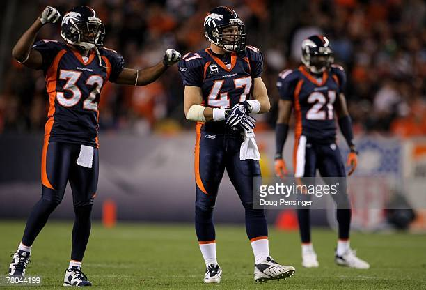 Safety John Lynch 47 cornerback Dre Bly and safety Hamza Abdullah of the Denver Broncos line up against the Tennessee Titans at Invesco Field at Mile...