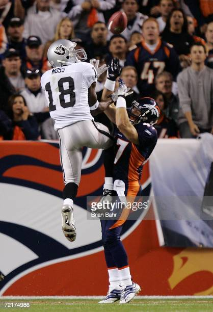 Safety John Lynch of the Denver Broncos breaks up a pass to Randy Moss of the Oakland Raiders in the first quarter on October 15 2006 at Invesco...