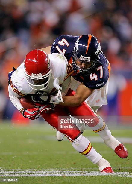 Safety John Lynch of the Denver Broncos hits Dante Hall of the Kansas City Chiefs in the fourth quarter September 26 2005 at Invesco Field at Mile...