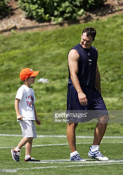 Safety John Lynch of the Denver Broncos looks to his son Jake inbetween sprints after practice during training camp on July 29 2006 at the Paul D...