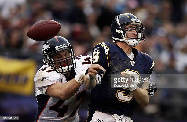 Safety John Lynch of the Denver Broncos sacks and forces a fumble on Quarterback Drew Brees of the San Diego Chargers during the 2nd quarter of their...