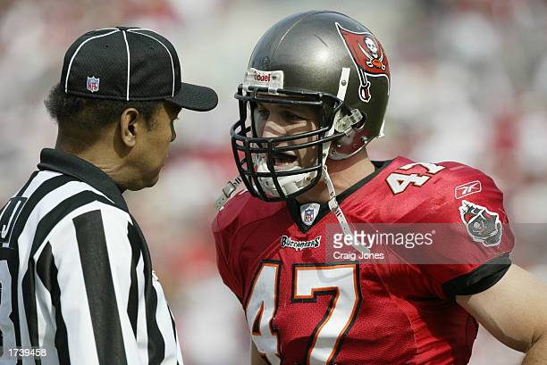 Safety John Lynch of the Tampa Bay Buccaneers talks with Line Judge Byron Boston during the NFC Divisional Playoff game against the San Francisco...