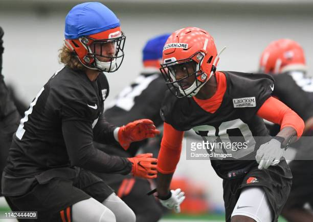 Safety Jontrell Rocquemore of the Cleveland Browns engages safety Brian Bell in a drill during a rookie mini camp on May 4 2019 at the Cleveland...