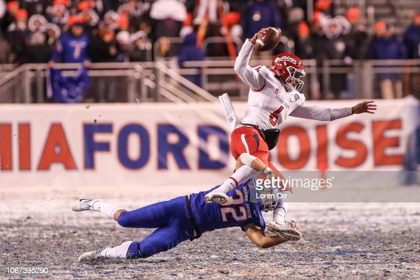 Safety Jordan Happle of the Boise State Broncos upends quarterback Marcus McMaryion of the Fresno State Bulldogs during second half action in the...