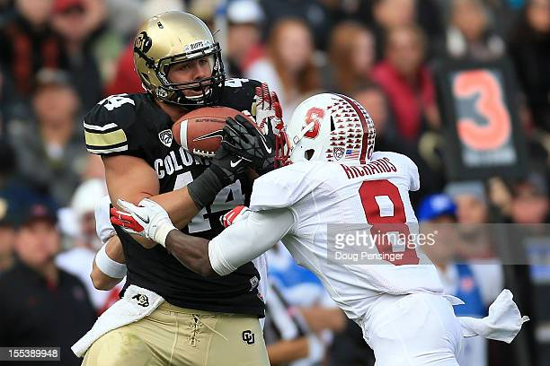 Safety Jordan Richards of the Stanford Cardinal breaks up a pass intended for tight end Nick Kasa of the Colorado Buffaloes to force a fourth down in...