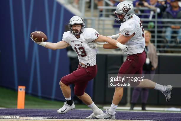 Safety Josh Sandry of the Montana Grizzlies celebrates after returning an interception for a touchdown against the Washington Huskies at Husky...