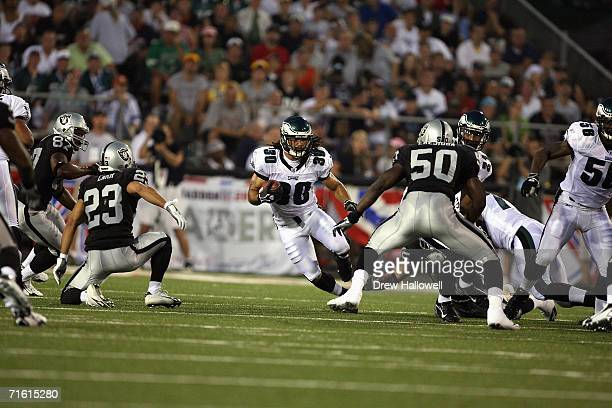 Safety JR Reed of the Philadelphia Eagles returns with the ball on August 6 2006 in the AFCNFC Pro Football Hall of Fame Game at Fawcett Stadium in...