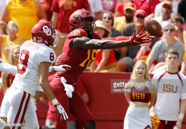 Safety Kahlil Haughton of the Oklahoma Sooners breaks up a pass meant for wide receiver Hakeem Butler of the Iowa State Cyclones in the end zone in...