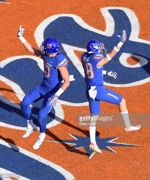 Safety Kekoa Nawahine and safety Kekaula Kaniho of the Boise State Broncos celebrate in the end zone after Kaniho intercepted a pass and ran it back...