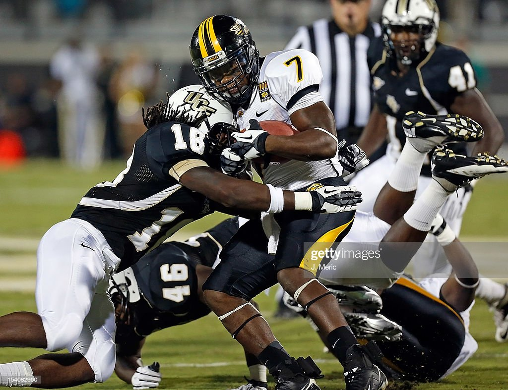Safety Kemal Ishmael #18 of the Central Florida Knights hits running back Desmond Johnson #7 of the Southern Mississippi Golden Eagles during the game at Bright House Networks Stadium on October 13, 2012 in Orlando, Florida.