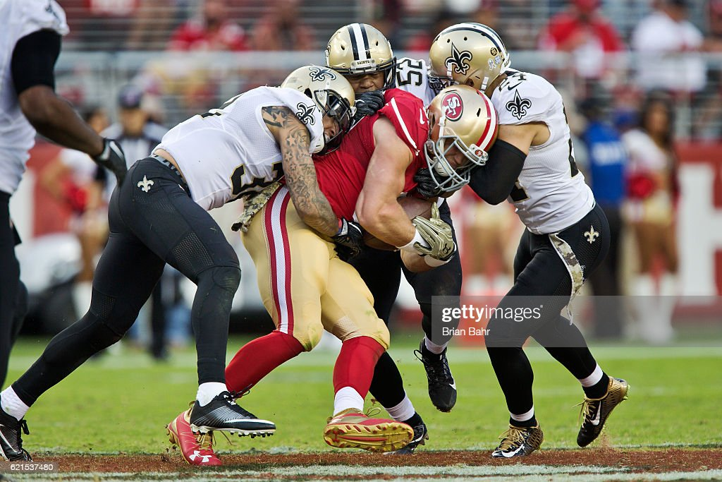 Safety Kenny Vaccaro #32, linebacker Craig Robertson #52, and cornerback Sterling Moore #24 of the New Orleans Saints gang up to bring down tight end Vance McDonald #89 of the San Francisco 49ers in the second half on November, 6 2016 at Levi's Stadium in Santa Clara, California. The Saints won 41-23.