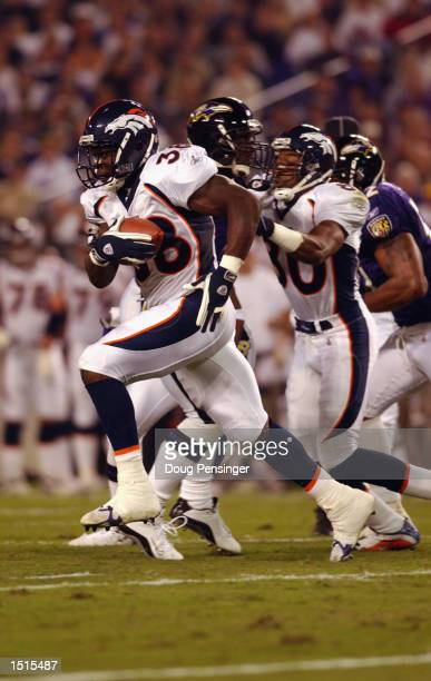 Safety Kenoy Kennedy of the Denver Broncos carries the ball up the field during the NFL Monday Night Football game against the Baltimore Ravens on...
