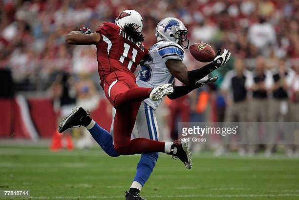 Safety Kenoy Kennedy of the Detroit Lions intercepts a pass intended for Larry Fitzgerald of the Arizona Cardinals in the first quarter at the...