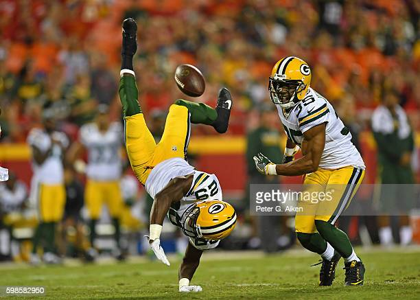 Safety Kentrell Brice of the Green Bay Packers can't hold onto a potential intercepting against the Kansas City Chiefs as teammate Jermaine Whitehead...