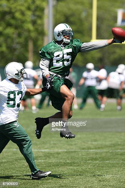 Safety Kerry Rhodes of the New York Jets goes high to grab the ball during practice on May 21 2009 in Florham Park New Jersey