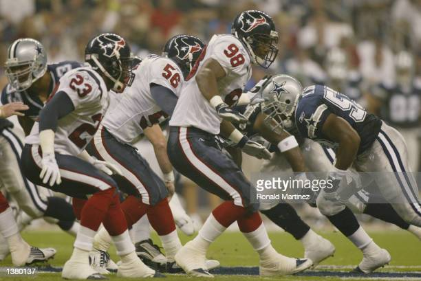Safety Kevin Williams and linebackers Jay Foreman and Jeff Posey of the Houston Texans drop to block as the team punts during the NFL game against...