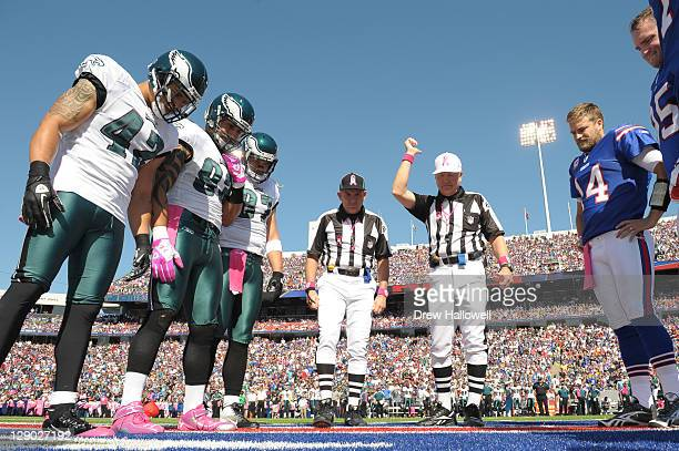 Safety Kurt Coleman defensive end Jason Babin and defensive tackle Cullen Jenkins of the Philadelphia Eagles watch the coin toss during the game...