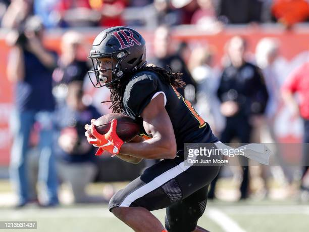 Safety Kyle Dugger from Lenoir Rhyne of the South Team runs back a punt return during the 2020 Resse's Senior Bowl at LaddPeebles Stadium on January...