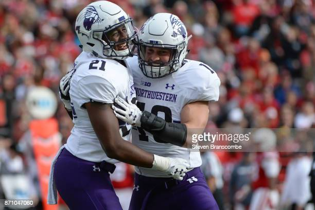 Safety Kyle Queiro of the Northwestern Wildcats celebrates an interception with linebacker Brett Walsh against the Nebraska Cornhuskers at Memorial...