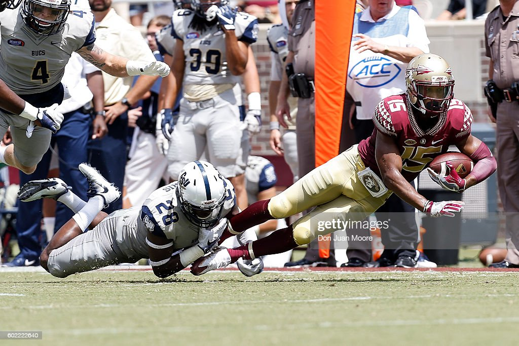 Safety Larenzo Mathis #28 of the Charleston Southern Buccaneers tackled Wide Receiver Travis Rudolph #15 of the Florida State Seminoles during the game at Doak Campbell Stadium on Bobby Bowden Field on September 10, 2016 in Tallahassee, Florida. The 3rd ranked Florida State defeated Charleston Southern 52 to 8.
