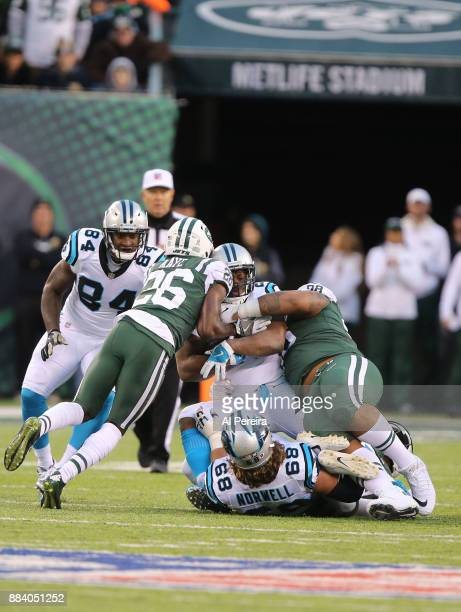 Safety Marcus Maye and Defensive Lineman Mike Pennel of the New York Jets make a stop against the Carolina Panthers during their game at MetLife...