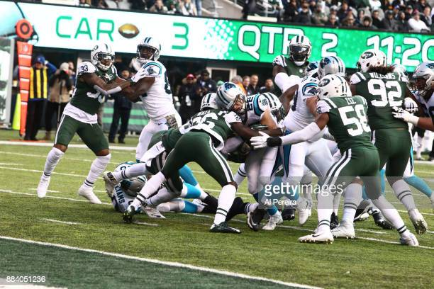 Safety Marcus Maye of the New York Jets makes a stop against the Carolina Panthers during their game at MetLife Stadium on November 26 2017 in East...