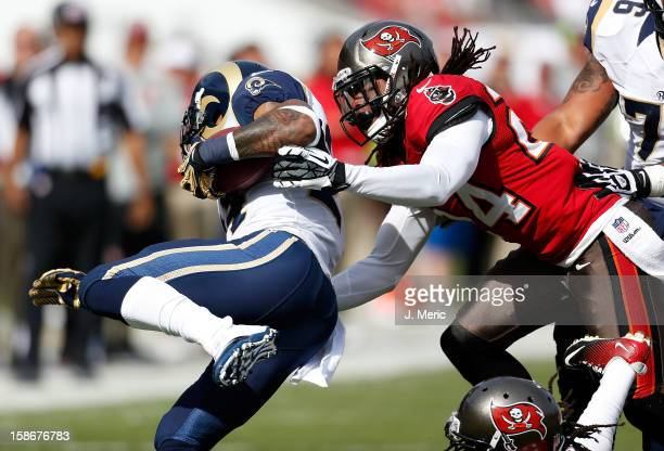 Safety Mark Barron of the Tampa Bay Buccaneers tackles running back Isaiah Pead of the St Louis Rams during the game at Raymond James Stadium on...