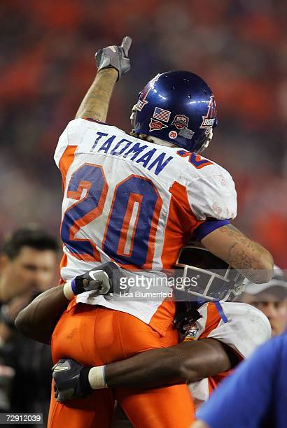 Safety Marty Tadman of the Boise State Broncos celebrates after scoring a touchdown on a 27yard interception return in the third quarter against the...