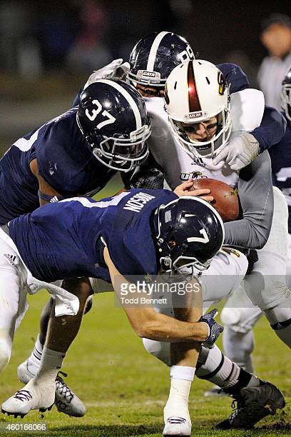 Safety Matt Dobson, linebacker Antwione Williams and defensive lineman Jay Ellison for the Georgia Southern Eagles sack quarterback Brayle Brown of...