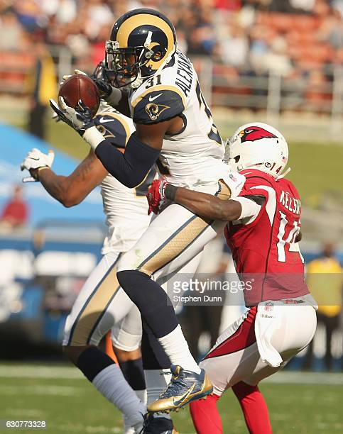 Safety Maurice Alexander of the Los Angeles Rams intercepts a pass intended for wide receiver JJ Alexander of the Arizona Cardinals in the second...