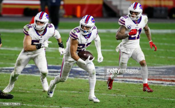 Safety Micah Hyde of the Buffalo Bills returns an interception ahead of teammates A.J. Klein and Jordan Poyer of the Bills during the second half of...