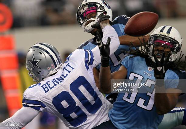 Safety Michael Griffin of the Tennessee Titans makes an interception in the end zone over tight end Martellus Bennett of the Dallas Cowboys at...