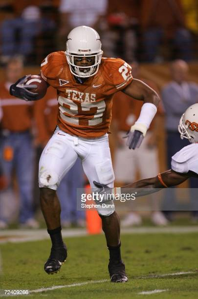 Safety Michael Griffin of the Texas Longhorns carries the ball after making an interception against the Oklahoma State Cowboys on November 4 2006 at...