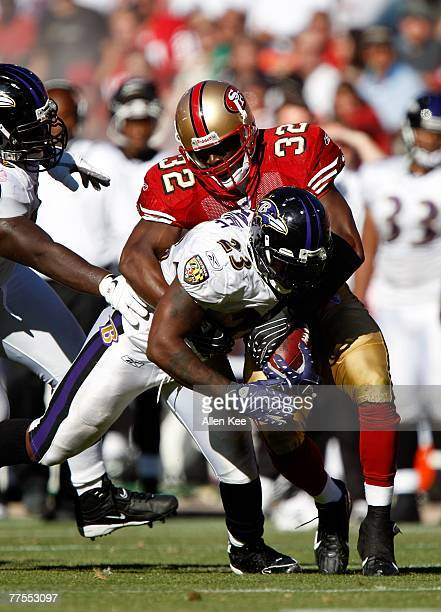 Safety Michael Lewis of the San Francisco 49ers tackles running back Willis McGahee of the Baltimore Ravens at Monster Park on October 7 2007 in San...