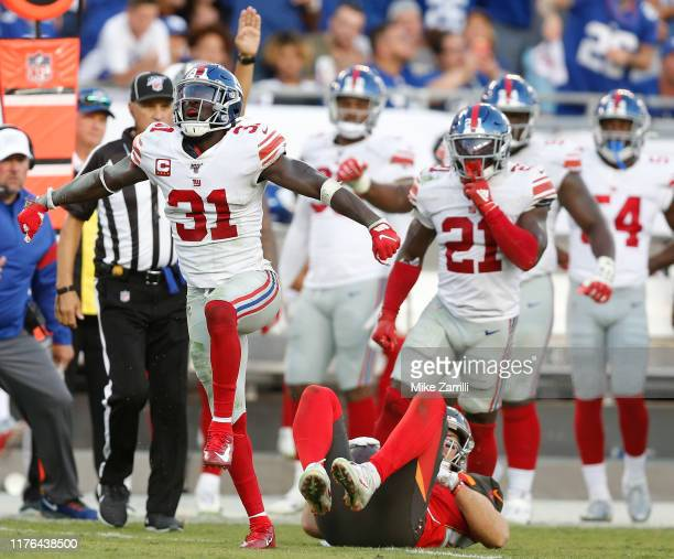 Safety Michael Thomas of the New York Giants celebrates after a tackle in the fourth quarter during the game against the Tampa Bay Buccaneers at...
