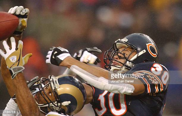 Safety Mike Brown of the Chicago Bears breaks up a pass intended for receiver Torry Holt of the St Louis Rams during a game on November 16 2003 at...