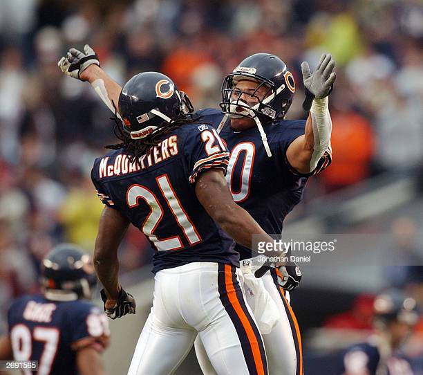 Safety Mike Brown of the Chicago Bears bumps chests with teammate RW McQuarters after McQuarters ran back a punt for big yardage in the fourth...