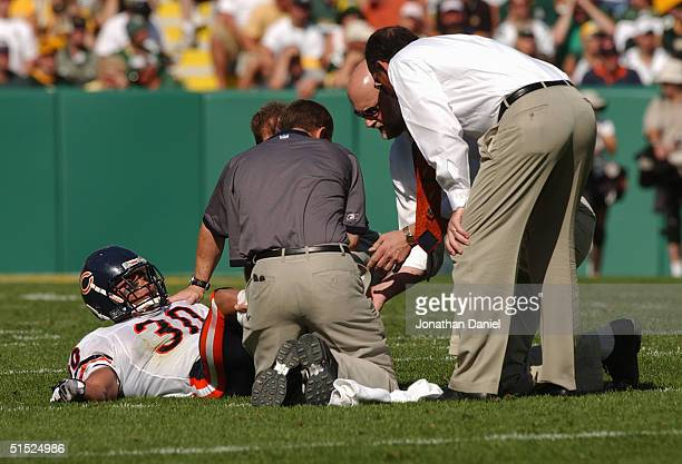 Safety Mike Brown of the Chicago Bears is injured during the game against the Green Bay Packers on September 19 2004 at Lambeau Field in Green Bay...