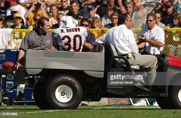 Safety Mike Brown of the Chicago Bears is taken off the field because of an injury during the game against the Green Bay Packers on September 19 2004...