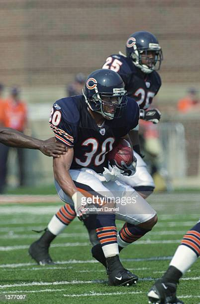 Safety Mike Brown of the Chicago Bears runs after a fourth quarter interception against the Minnesota Vikings during their game on September 8 2002...