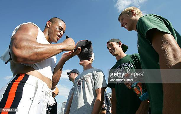 Safety Mike Brown of the Chicago Bears signs an autograph for fans after a practice at the Bears summer training camp on July 28 2005 at Olivet...