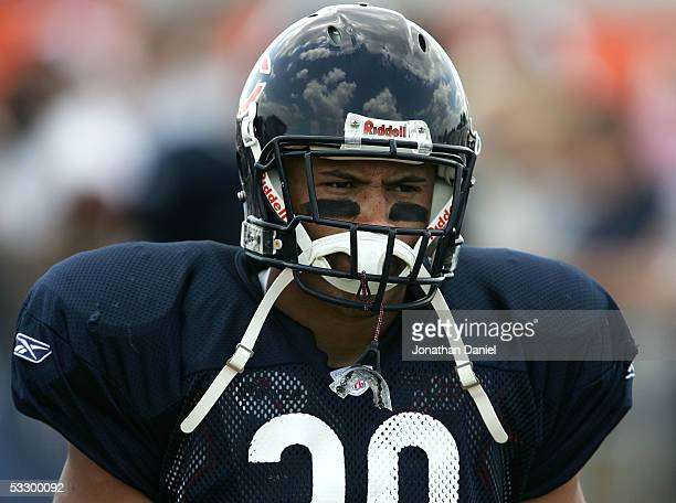 Safety Mike Brown of the Chicago Bears walks out to the field for practice at the Bears summer training camp on July 28 2005 at Olivet Nazarene...