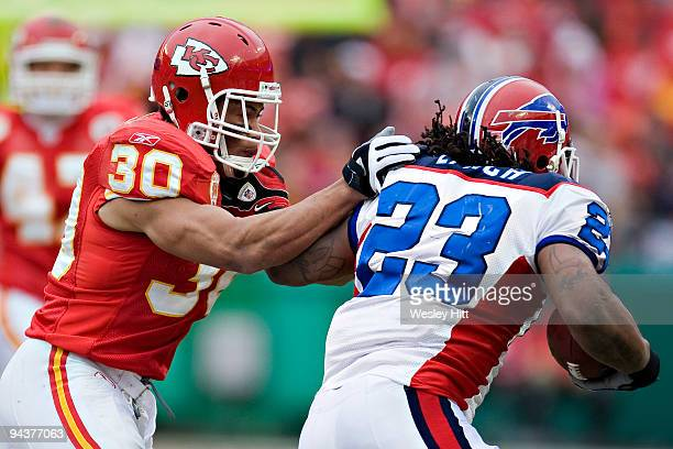 Safety Mike Brown of the Kansas City Chiefs tackles running back Marshawn Lynch of the Buffalo Bills at Arrowhead Stadium on December 13 2009 Kansas...