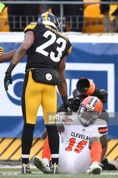 Safety Mike Mitchell of the Pittsburgh Steelers offers a hand to wide receiver Corey Coleman of the Cleveland Browns in the fourth quarter of a game...