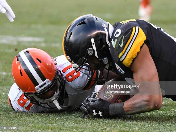 Safety Mike Mitchell of the Pittsburgh Steelers recovers a fumble in the fourth quarter of a game on December 31 2017 against the Cleveland Browns at...