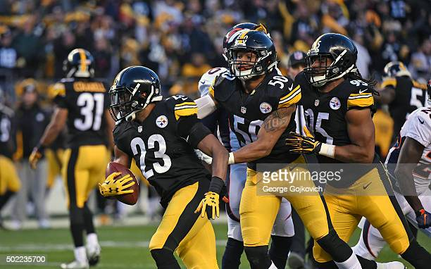 Safety Mike Mitchell of the Pittsburgh Steelers runs with the football with help from linebackers Ryan Shazier and Jarvis Jones after Mitchell...