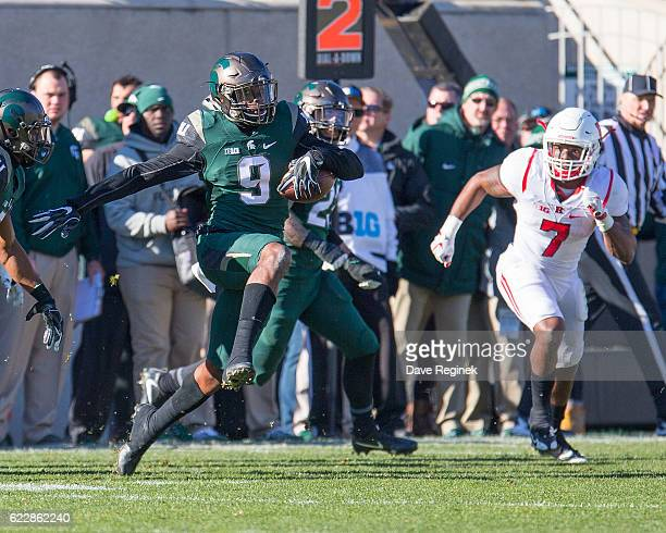 Safety Montae Nicholson of the Michigan State Spartans intercepts a pass in the second half and runs with the football as running back Robert Martin...