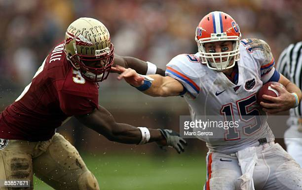 Safety Myron Rolle of the Florida State Seminoles tackles quarterback Tim Tebow of the Florida Gators during the first half at Bobby Bowden Field at...