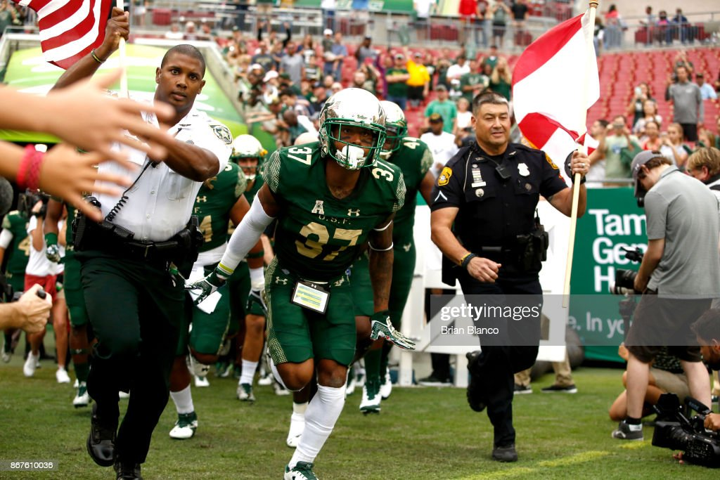Safety Nate Ferguson #37 of the South Florida Bulls joins teammates as he takes to the field along side first responders at the start of an NCAA football game against the Houston Cougars on October 28, 2017 at Raymond James Stadium in Tampa, Florida.