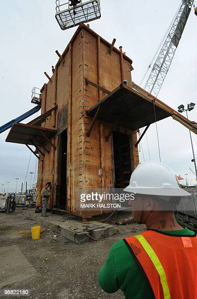 A safety officer watches as the Pollution Control Dome is built by steelworkers at the Martin Terminal worksite in Port Fourchon as BP rushes to cap...